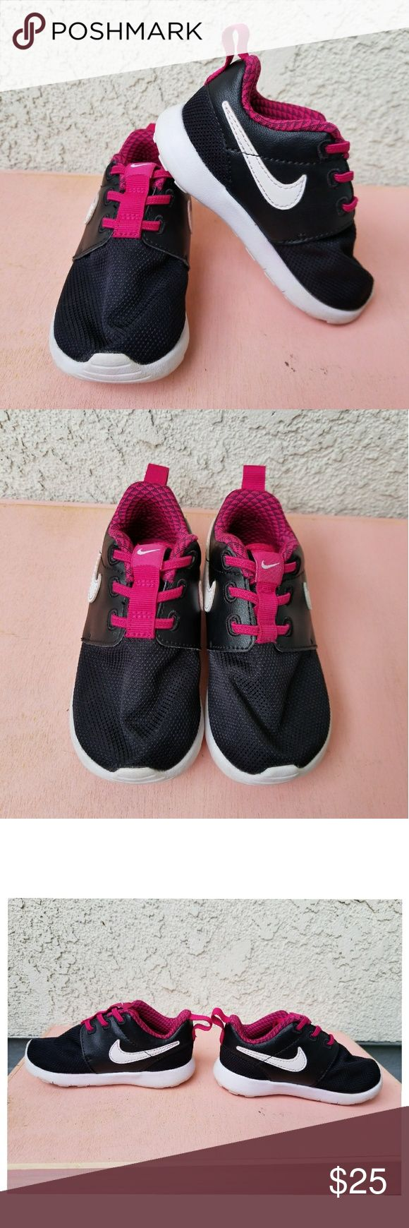 Toddler Girls Nike Shoe w/Fuchsia Toddler Girls Black and white shoe with Fuchsia lining. Great condition. Size 6. Perfect for every toddler, the laces always stay put, they don't unravel. Nike Shoes Sneakers