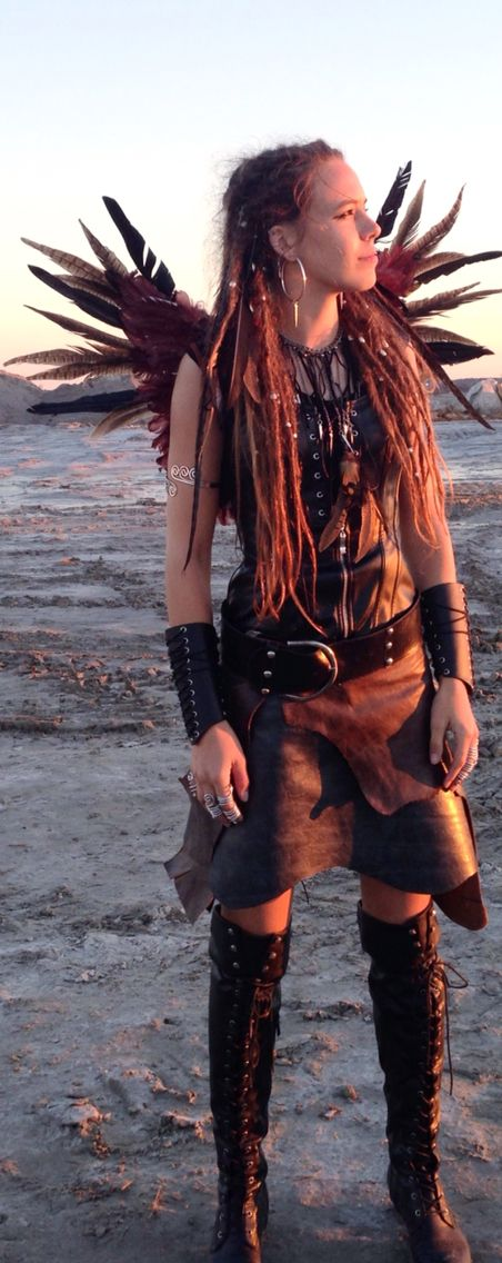 new costume I created last week! Viking tribal phoenix princess warrior fairy barbarian bird falcon goddess cosplay something boho bohemian fashion clothes jewelry makeup fusion hair feathers leather chains studded boots belt corset wings skirt dreadlocks locs