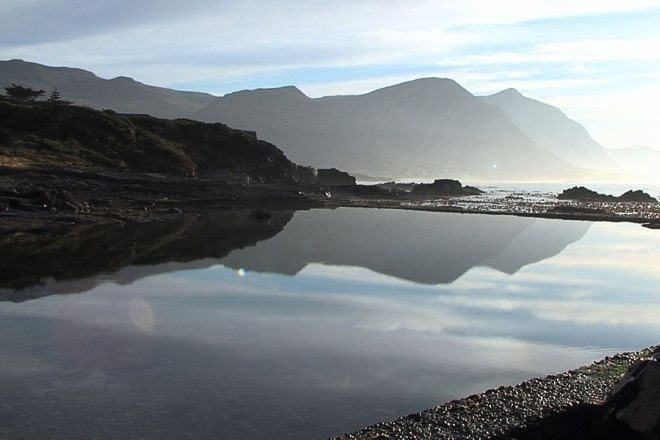A tidal pool with the Hermanus mountains in the background