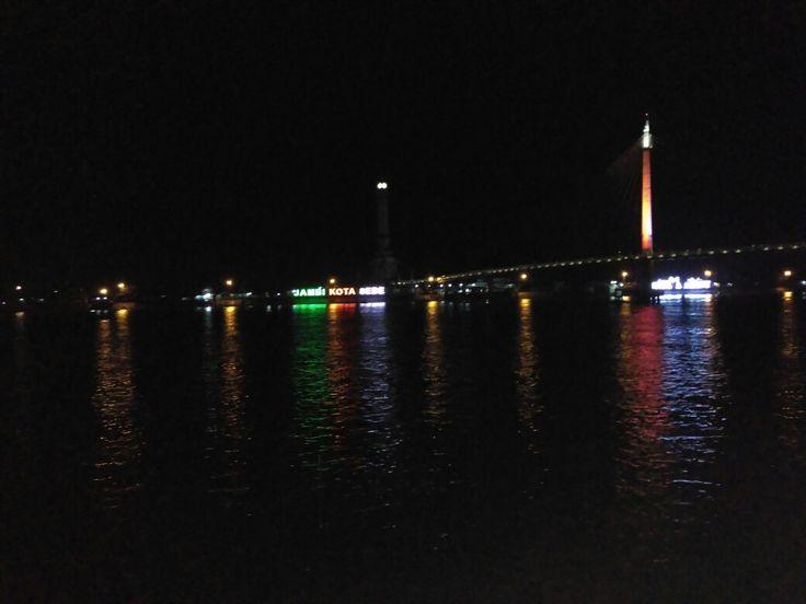 Angso Duo bridge at night on Batanghari river, Jambi