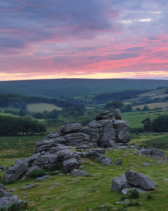 Hound tor is one of the most well known tors on Dartmoor, home to Conan Doyle's 'The hound of the Baskervilles'. Steeped in history and myth. It's certainly worth a visit plus it doesn't involve a long hike! The Hounds by ~PastyGuy on deviantART
