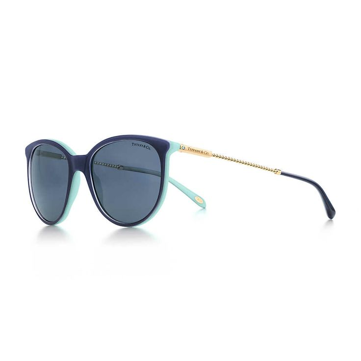 Tiffany Twist round sunglasses in pale gold-colored metal and navy blue acetate. $290