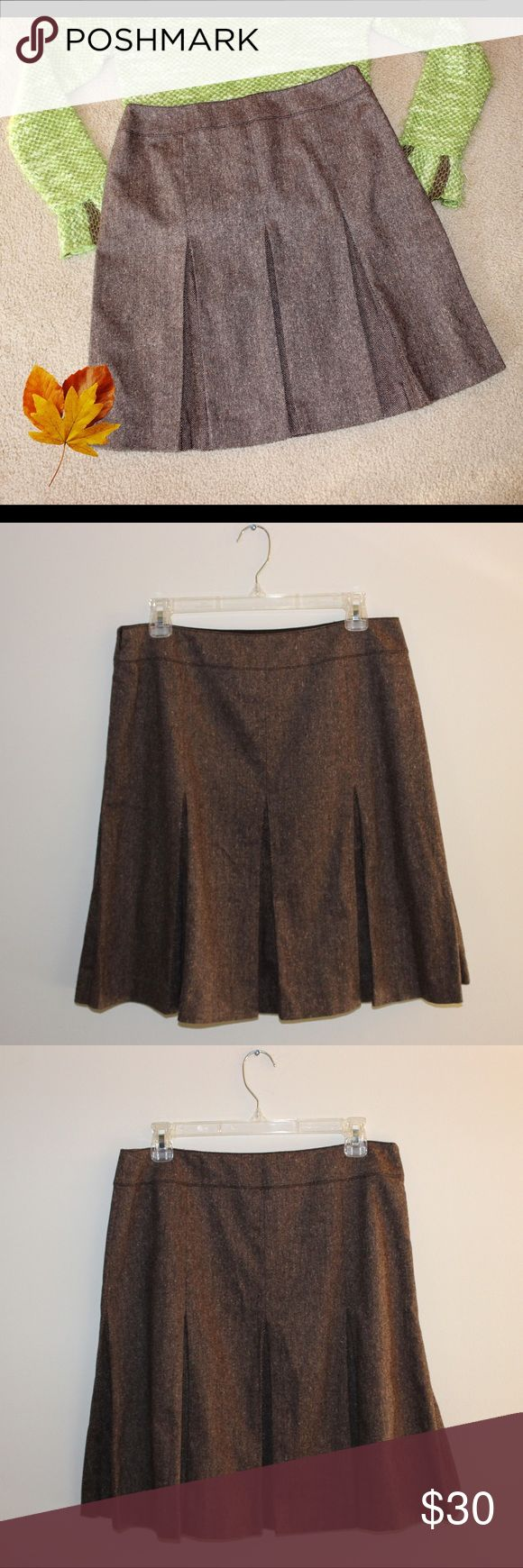 """CITY DKNY Wool Blended Pleated Skirt What a classy and versatile skirt!   * Color - Browns, tans * Waistband * Side zip * Stretchy * Pleated front and back * Fully lined with 100% acetate * Shell - 39% polyester / 31% wool / 23% acrylic / 6% nylon / 1% spandex  MEASUREMENTS   * Waist 15.5"""" * Hips 42"""" * Length 21.5""""  This skirt by CITY DKNY is in excellent condition, without flaws, and is a size 8. CITY DKNY Skirts"""