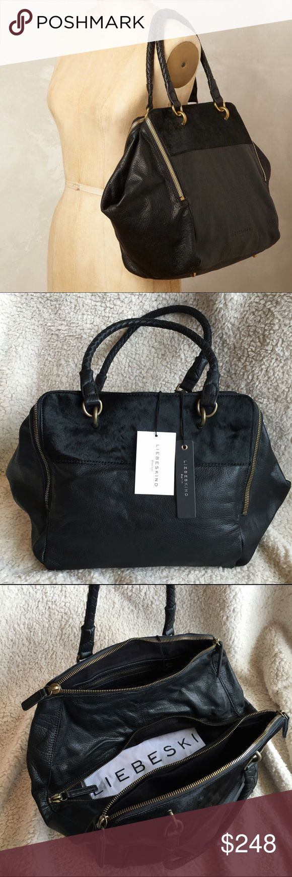"""NWT: Liebeskind Black Kayla Pony Satchel NWT: Liebeskind Berlin black genuine leather Kayla satchel with genuine calf hair detail on the front, bronze hardware, dual braided handles, multiple zip-top compartments, metal feet, and dust bag. No crossbody strap. Size: Approximately 12""""H x 19""""L x 6""""D, 7"""" strap drop. Brand new with tags. Liebeskind Bags Satchels"""