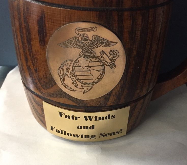 US Marine core logo and onyx font laser engraved on brass plates mounted on going away gift: a wooden mug!