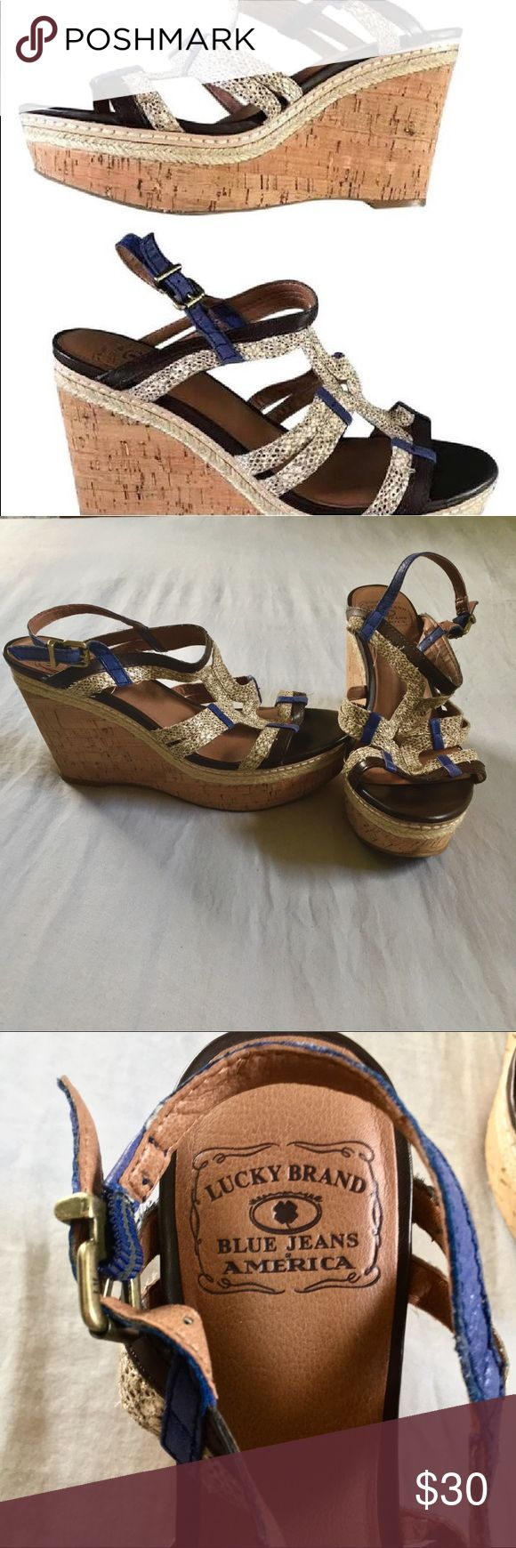 Lucky Brand Snakeskin wedge sandal sz.9 Snakeskin print multi colored wedge from Lucky Brand. Size 9. Platform cork sole makes these super comfortable. Brown, snakeskin, and navy blue coloring. Some sign of wear on the upper, but like new on the soles, 3.5 inch height. Lucky Brand Shoes Wedges