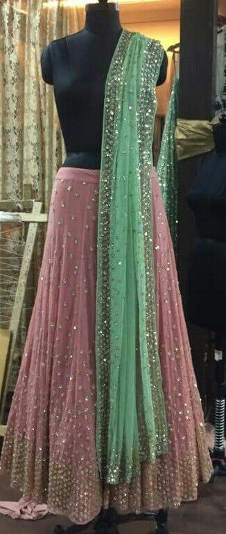 Pink lehenga with green dupatta with sequins work and heavy blouse Price-24500/-