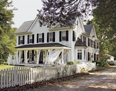 Lovely home.: White Houses, Farms Houses, Dreams Home, Dreams Houses, Porches Curtains, Black Shutters, Outdoor Curtains, Front Porches, White Picket Fence