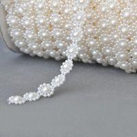 NUEVA LLEGADA EN LA ACCIÓN! De 25Meters 10mm perla de cuentas de Garland Hebras de decoración de la boda Centros de mesa Araña
