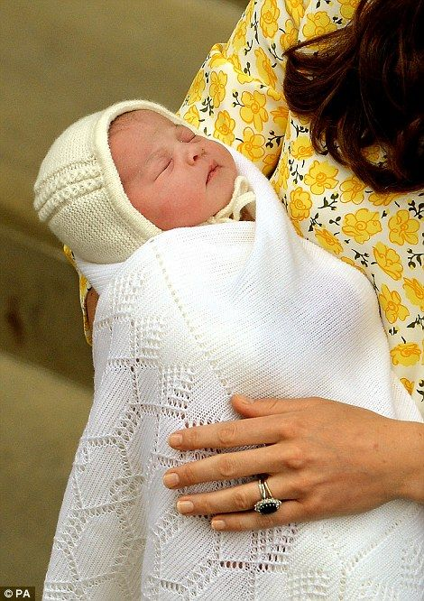 The royal baby, who will be fourth in line to the throne, emerged with his parents on the ...