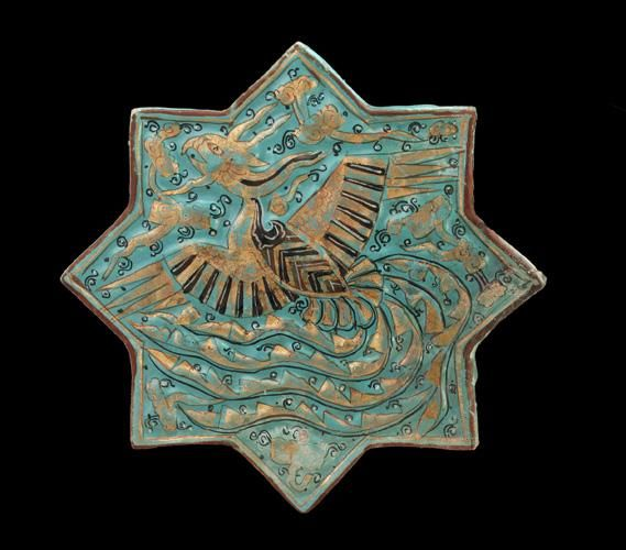Tile | Origin: Takht-i Sulayman, Iran | Period: 14th century Il-khanid period | Details: In the Islamic world, ceramics makers emphasized brightly colored glazes and intricate designs to animate relatively simple shapes and architectural tiles. Drawing on a variety of decorative sources, they continually expanded and refined their repertoire of calligraphic, abstract, and figurative motifs. Some of the designs, such as the soaring phoenix on this fourteenth-century turquoise molded tile…