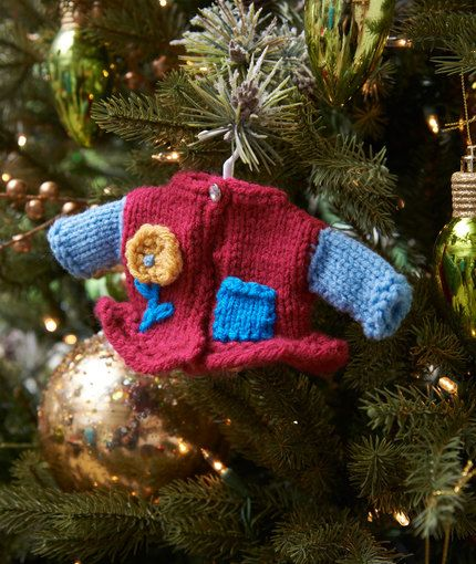 Girlie Fashion Sweater Ornament - free Knitting Pattern   Red Heart; Knit a sweater for the tree! This darling sweater has a girlie look and is a nice gift