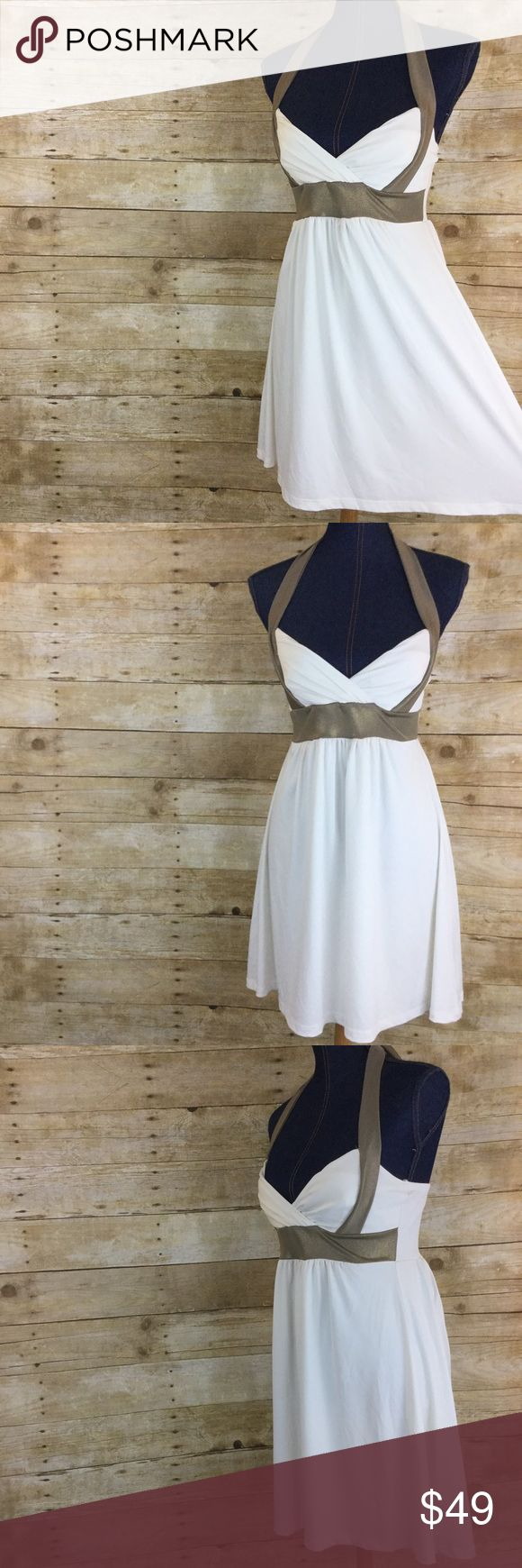 BODY CENTRAL Small White Empire Waist Halter Dress BODY CENTRAL Small White Empire Waist Halter Dress. Nice pre-loved condition! Very slimming and fit at up to a D cup. More info in pics.  White/bronze. Love this summer sundress! Body Central Dresses Mini