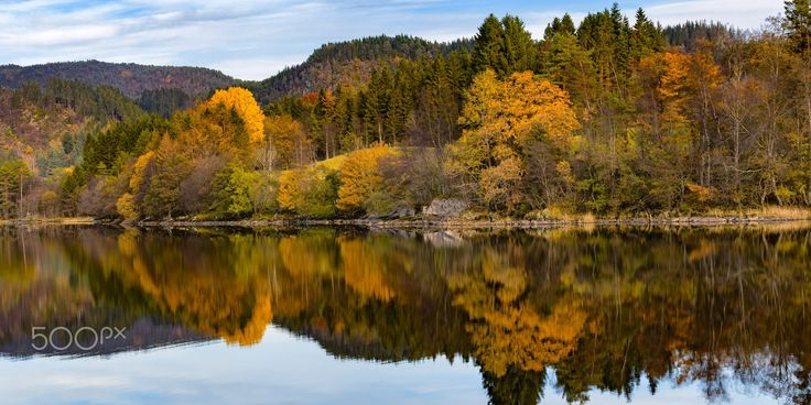 Autumn Colors At The Lake - Autumn colors reflecting in a a calm lake.