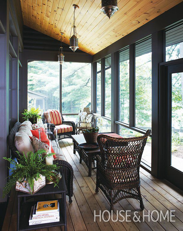 On rainy days or mosquito season nights, this screened-in porch is a favorite gathering spot. | Photographer: Angus Fergusson | Designer: Ana Lopes and Don Tapscott