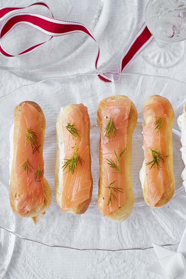 The perfect festive canapé – the classic flavour pairing of smoked salmon and horseradish has been used to make these savoury eclairs all the more special | Tesco