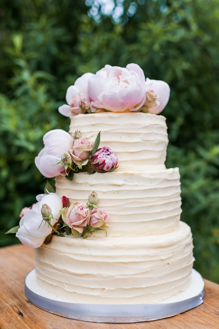 The 25 best wedding cake table decorations ideas on pinterest home made three tiered wedding cake consisting of a bottom layer of carrot cake a junglespirit