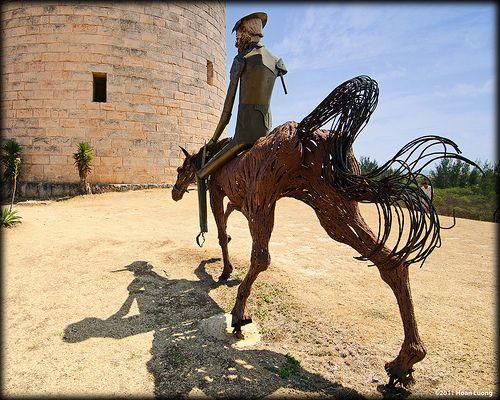 Don Quixote tilting at windmill