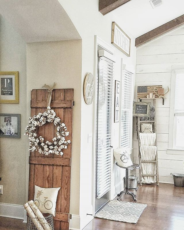 So much to love! The blanket ladder, the pillows the door with cotton wreath!  The tractor seat...