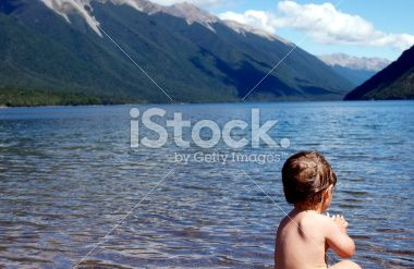 Child by Lakeside, Nelson Lakes, New Zealand Royalty Free Stock Photo