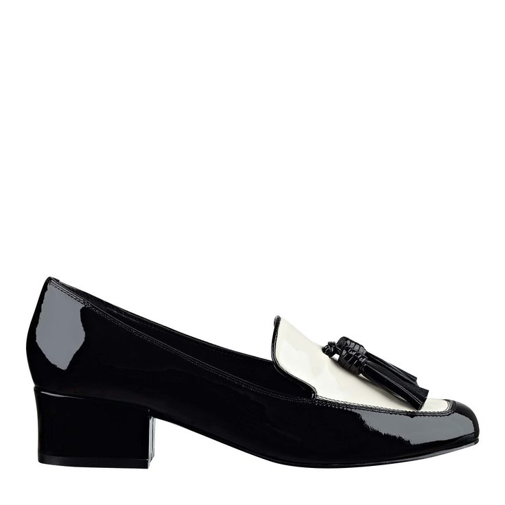Patent leather two-tone spectator loafer with mid block heel and front  tassel detail.