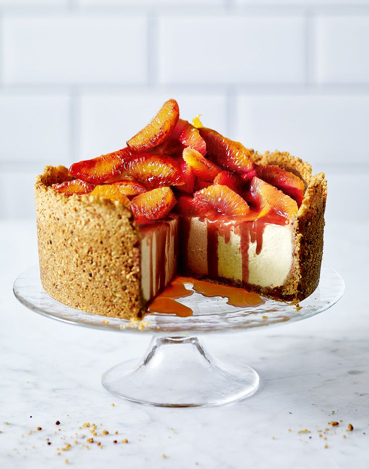 Vanilla cheesecake with blood oranges, caramel and hazelnut Hobnob crust - You can make this cheesecake recipe up to two days before serving – just add the oranges and caramel at the last minute.