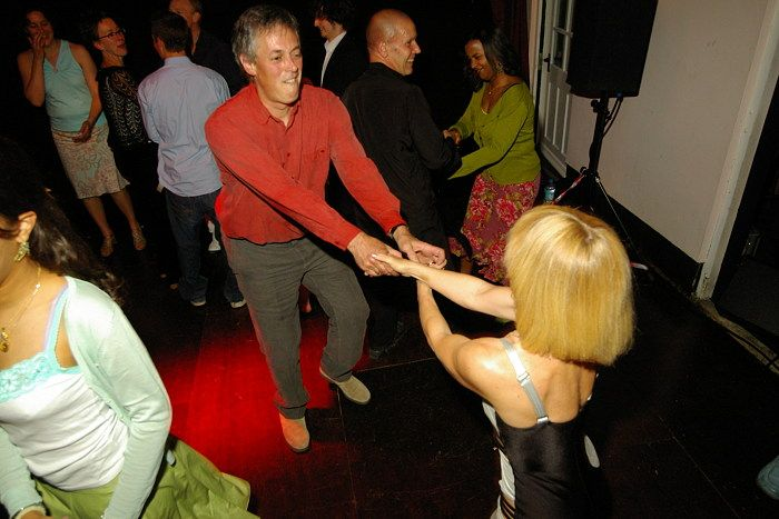David, Viscount Lascelles (later 8th Earl of Harewood), dancing with his cousin's bride, Fiona Wilmott (2006)