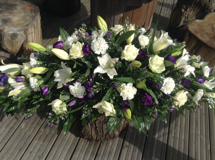 Funeral Flowers. white lily coffin spray, funeral flowers, purple and white coffin spray, casket spray www.thefloralartstudio.co.uk