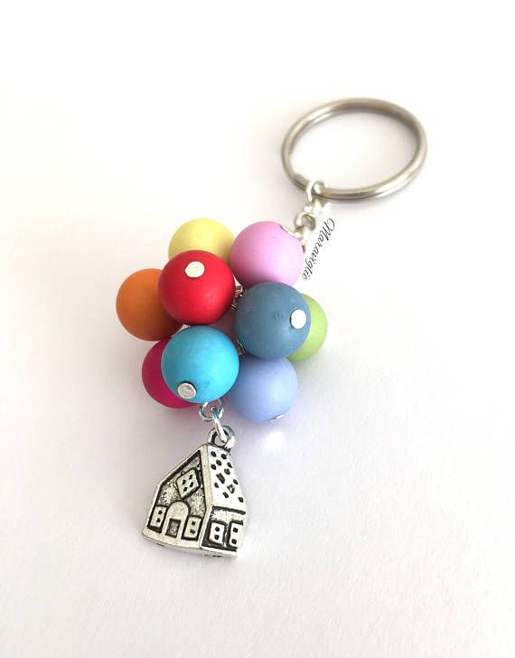 This lovely key ring is inspired by Disney s movie Up. It features a house charm that measures 17 x 14 mm and 10 coloured beads (10 mm). It is nickel free and will be shipped in a free organza gift bag, securely packaged inside a bubble envelope ready to use or gift to someone special!