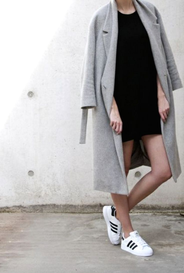 short dress, long coat and trainers