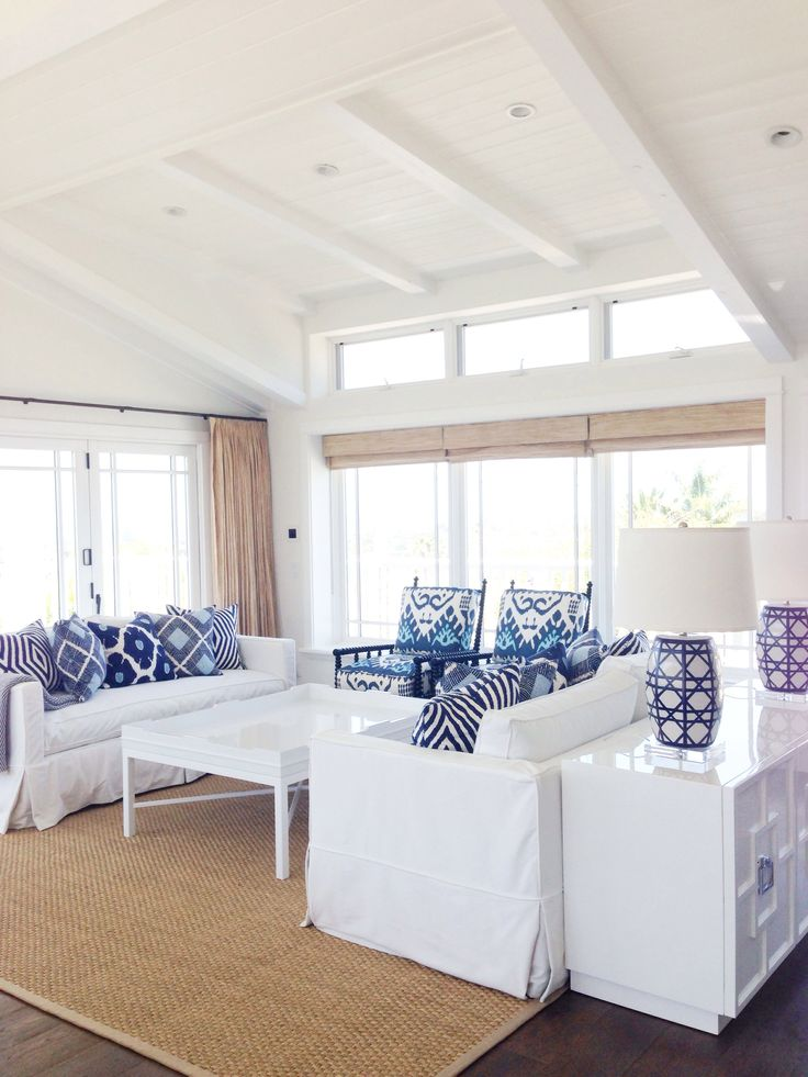 Bixby & Ball Design - John Robshaw indigo pillows, white sofas, white coffee table, neutral rug, natural window treatments, blue and white lamps - LOVE this, would add in pops of yellow, orange, and/or pink