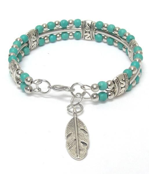 Turquoise Beaded Silver Leaf Bracelet Two rows of turquoise beads with silver connector beads. Silver rod beads separate the two beaded rows. Silver etched le