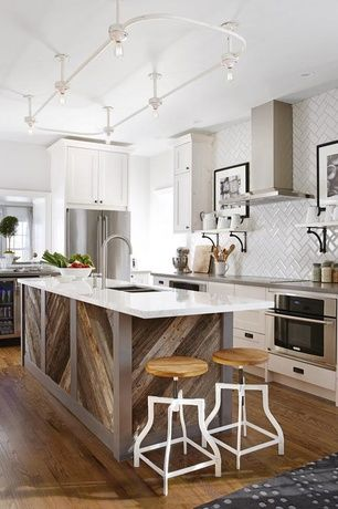 Eclectic Kitchen with L-shaped, Wine refrigerator, Kitchen island, Flat panel cabinets, Caesarstone London Grey Quartz, Flush