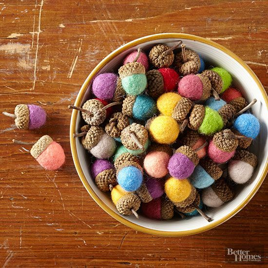 Improve on Mother Nature's handiwork by subbing pretty felted balls for the brown base of fall acorns. For each ball, place small wispy tufts of wool roving in a pile (each of our balls is made from five 4x4-inch tufts). Place the pile in your hand and place a small pebble in center of the pile. Wrap the wool around the pebble to create a ball of roving in your fist. Work over a sink and add warm water and a bit of bar soap to the ball; gently start rolling, increasing the pressure as you…