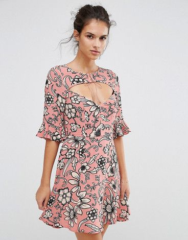 Ayla laced up dress in print by For Love And Lemons. Dress by For Love And Lemons, Textured woven fabric, Floral print design, Lace front detail, Flared sleeves, Zip back...