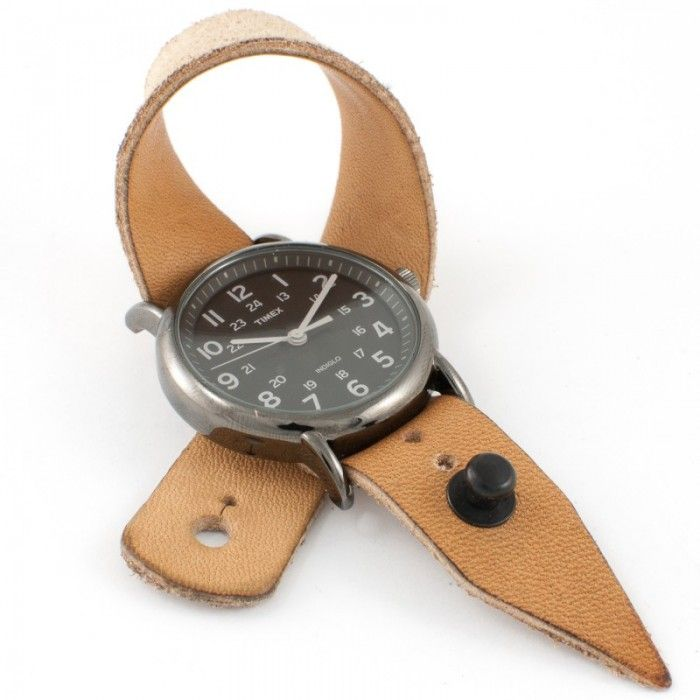 Nice use of a small pieces of leather and a button stud as closure for a watch band. Button Studs and leather can be purchased at Standing Bear's Trading Post 7624 Tampa Avenue, Reseda, CA. 91335 http://www.sbearstradingpost.com 818-342-9120