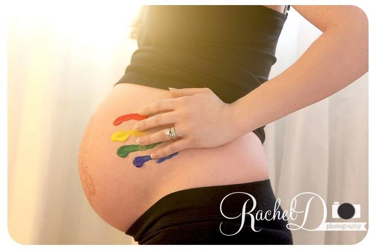 Rainbow baby photo. A rainbow baby is a baby born after a miscarriage or still birth