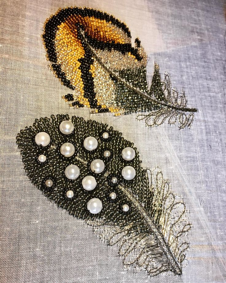 Pheasant and Guinea feathers. A darker version than I have done before, using dark grey beads, circled 'pearls' with black beads. I have used #tambourembroidery with gutermann sulky silver metallic thread which catches the light. .  .  .  .  .  .  .  #embroideryart  #embroiderydesign #makersofinstagram #ceridesignstudio #embroideryinstaguild #makers #embroideryartist #tambour #aari #zardozi #zardosiembroidery #stichersofinstagram #needlework #artist #artwork #artstudio #artistsoninstagram
