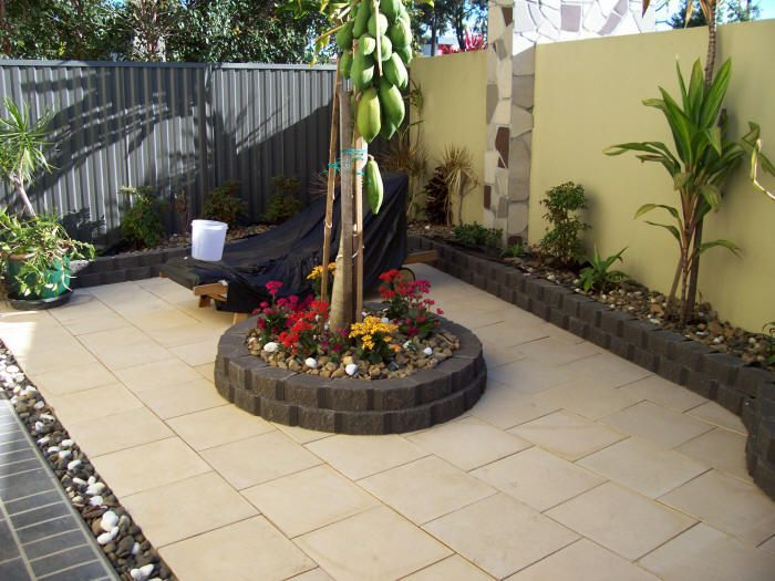 paver to garden to fence