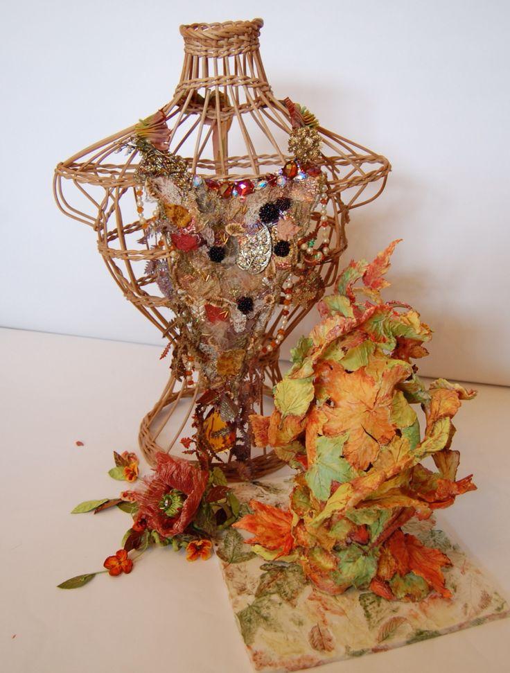 Autumn neckpiece and head dress by Jan Knibbs with bronze sculpture and ceramic piece by Liz Watts