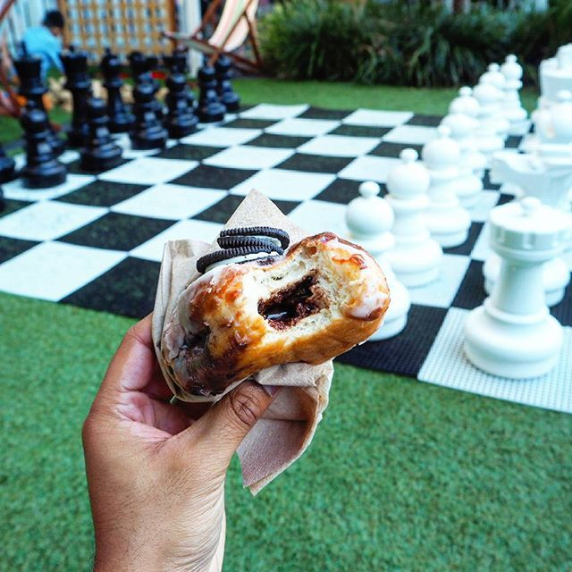Here's a shot of the filling in the @doughnuttime #cookiesncreme flavoured doughnut. A delicious rich chocolate filling, vanilla glaze and topped with a crushed oreo. All I can say is amazing!!! The chess set provided a perfect backdrop.