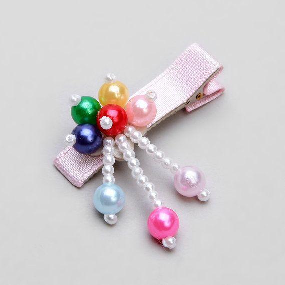 broche con perlas