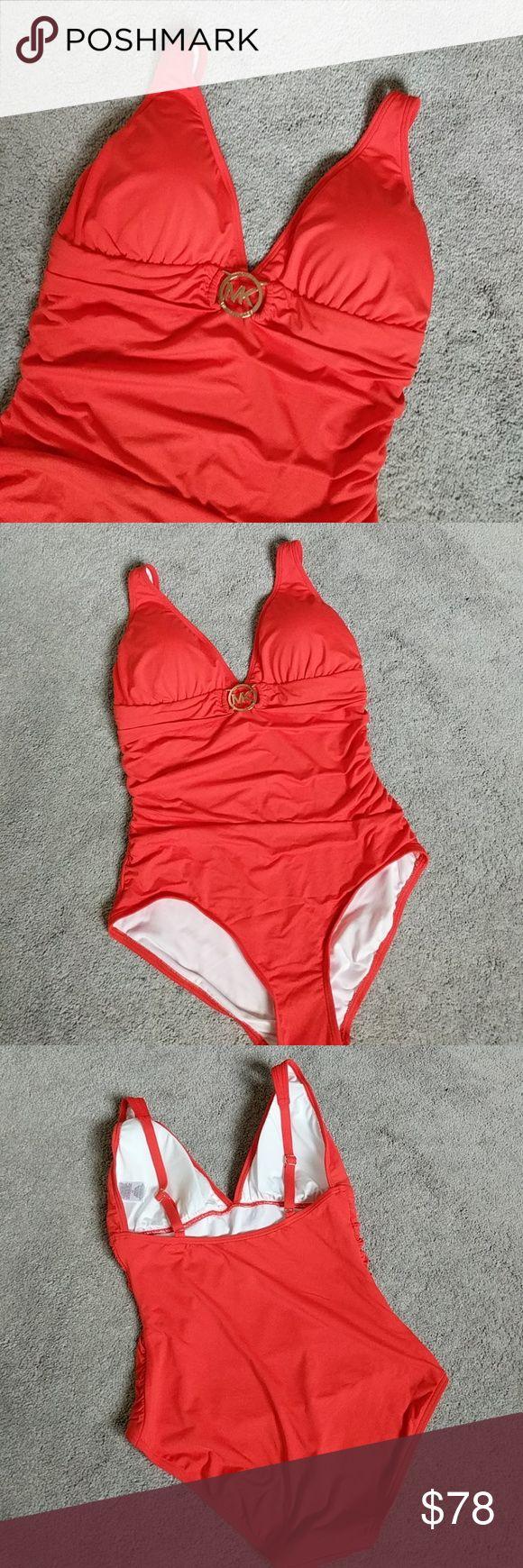 "🎀Michael Kors Orange One Piece Swimsuit 17"" flat across hips14.25"" across bust  Padded bust  Adjustable straps to fit Michael Kors Swim One Pieces"