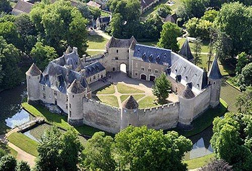 Château d'Ainay-le-Vieil, Ainay-le-Vieil, Cher, France. www.castlesandmanorhouses.com Built in the 14th century, this moated castle has been listed as a Monument historique since 1968 by the French Ministry of Culture
