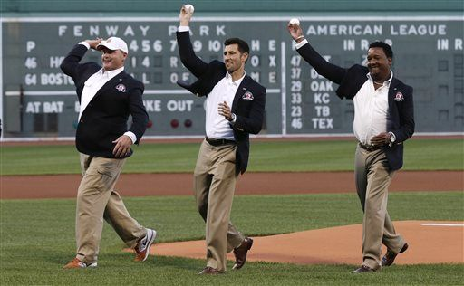 Boston Red Sox greats Roger Clemens, Nomar Garciaparra and Pedro Martinez throw out the ceremonial first pitch prior to the game at Fenway Park, Thursday, Aug. 14, 2014. Clemens, Garciaparra and Martinez were inducted into the Boston Red Sox Hall of Fame earlier in the day along with Red Sox radio announcer Joe Castiglione.