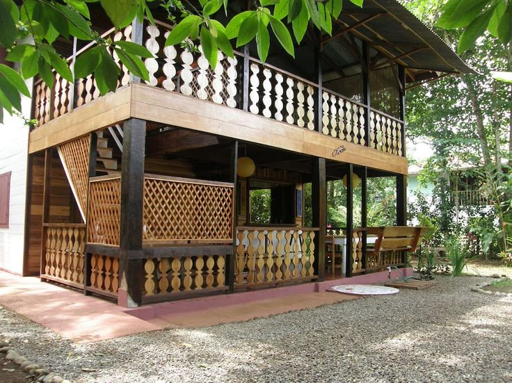 House in Puerto Viejo de Talamanca, Costa Rica. Typical caribbean wooden Lodge with 2 floors, 2 bedrooms with double standard  bed, fully equipped traditional kitchen, tropical garden, internet access, safe, private parking, free bikes, close to the beach, only 10 min.  The LODGE (120 sq. meter...