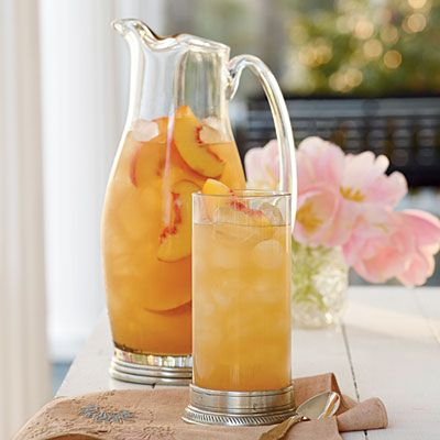 Governor's Mansion Summer Peach Tea Punch | Great for a Southern summer party, this peach sweet tea punch is a refreshing crowd pleaser. | Classic Southern #Recipes | SouthernLiving.com