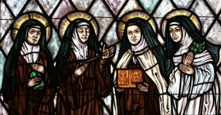 Edith Stein, St Teresa of Avila, St Thérèse of Lisieux and St Catherine of Siena are depicted in a stained-glass window in Montauk, New York (Photo: CNS)
