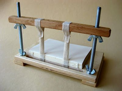 Bookbinding sewing frames were in use in Northern Europe by the 12th century and probably as early as the 11th. The frames remain more or less unchanged today and sewing on a frame is also unchanged.Used to set up  and sew a multi-section book, on tapes, on a frame.