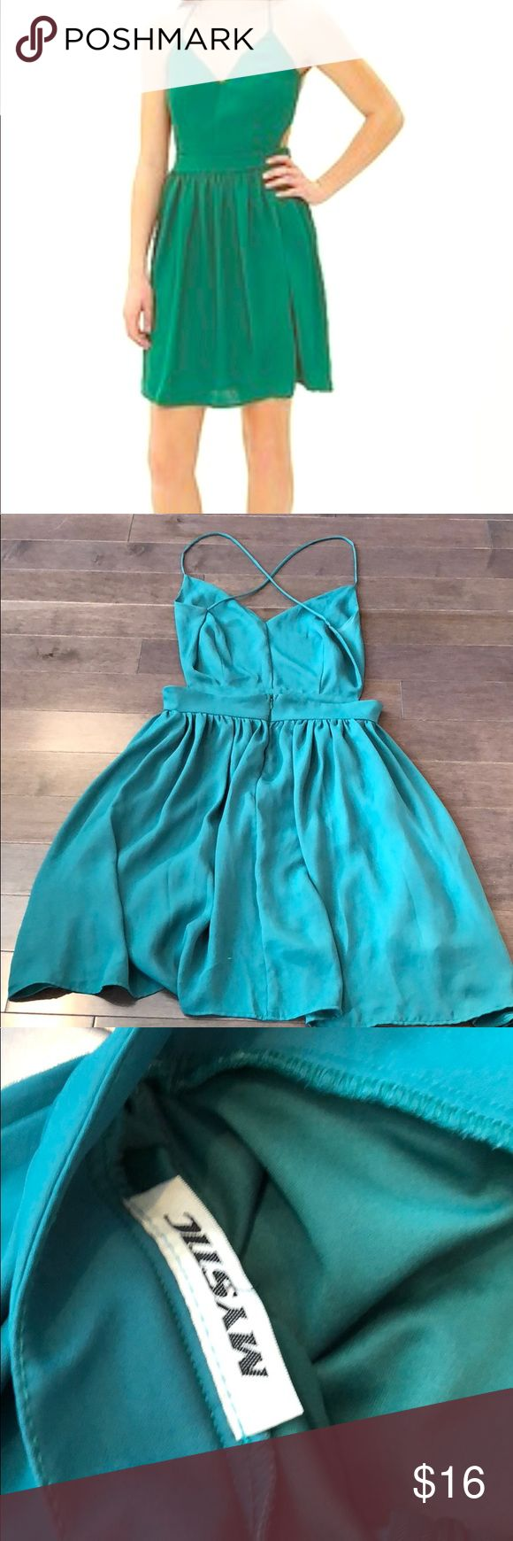 Emerald green backless Party dress- M Such a fun dress for a date or girls night. Cut out on sides, open back with cross cross straps. Hidden zip. Full skirt. Great for dancing. Mystic Dresses Backless